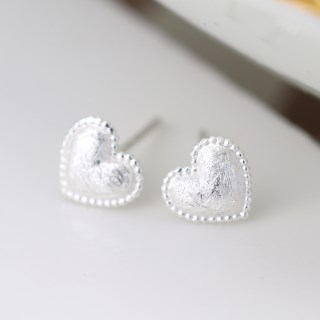 Sterling silver heart stud earrings with a scratched finish | Image 4