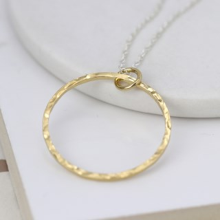 Gold hammered circle pendant on a fine silver chain | Image 2
