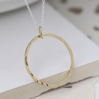 Gold hammered circle pendant on a fine silver chain | Image 3